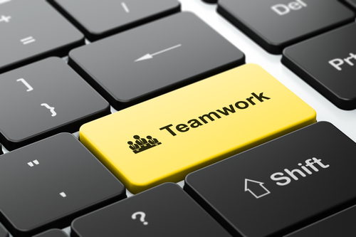 Finance concept: Business Team and Teamwork on computer keyboard background